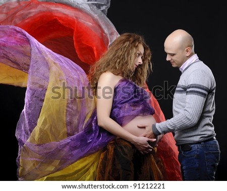 young family with pregnant mother in love