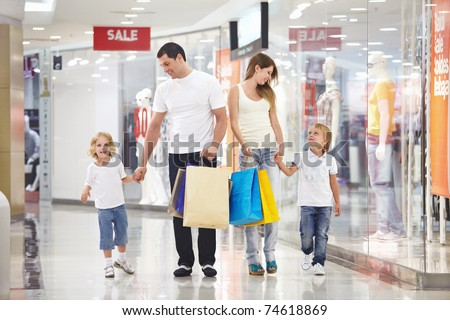 Young family with two children walking to the shops