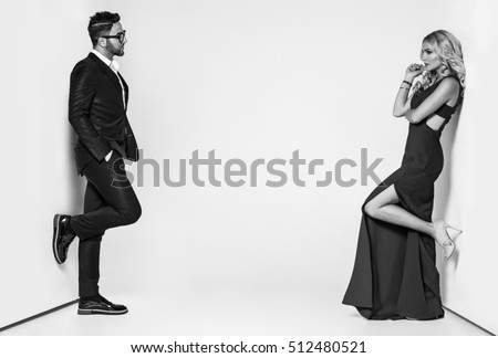 young fashion couple on a white background in studio