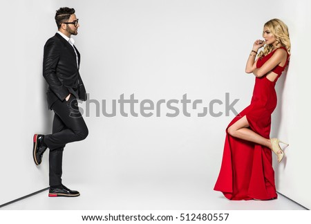 young fashion couple on a white background in studio #512480557