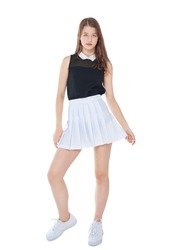 Young fashion girl in white skirt posing isolated on white background