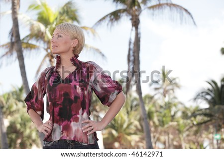 Young fashion model posing in a nature setting