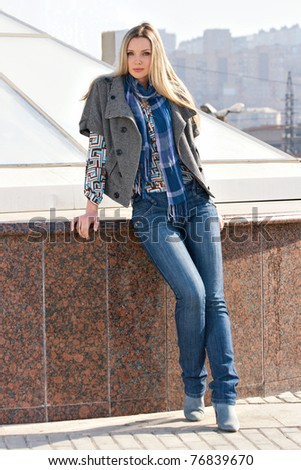 Young fashion model walking at the city