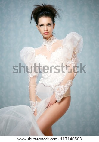 Young fashion model wearing lace body suit