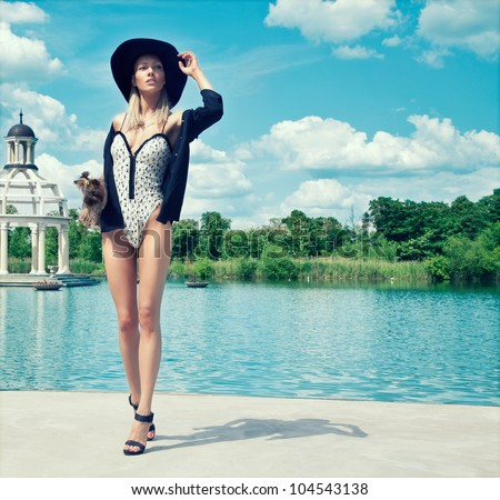 Young fashion woman on the swimming pool
