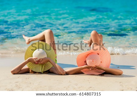 Young fashion woman relax on the beach. Happy island lifestyle. White sand, blue cloudy sky and crystal sea of tropical beach. Vacation at Paradise. Ocean beach relax, travel to Maldives islands #614807315