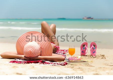 Young fashion woman relax on the beach. Happy island lifestyle. White sand, blue cloudy sky and crystal sea of tropical beach. Vacation at Paradise. Ocean beach relax. #636914863