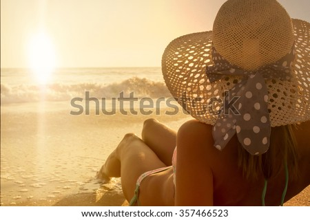 Young fashion woman sunbathing relax on the beach