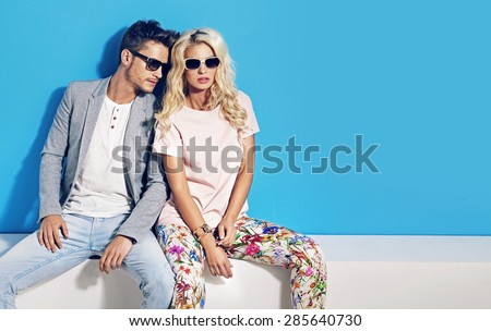 Young fashionable couple on blue background #285640730
