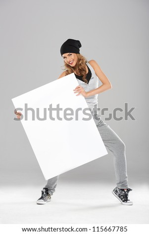 Young fashionable modern dancer holding white empty board