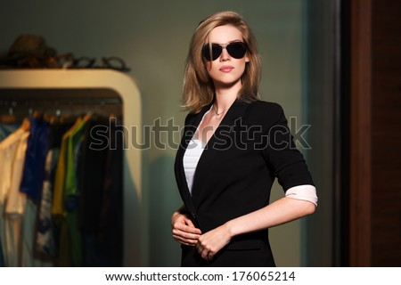 Young fashionable woman in the mall interior