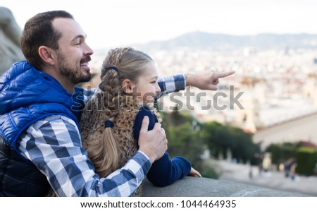 young father and daughter pointing at sight during sightseeing tour outdoors #1044464935