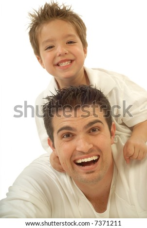 Young father and his toddler son playing around and laughing; isolated on white
