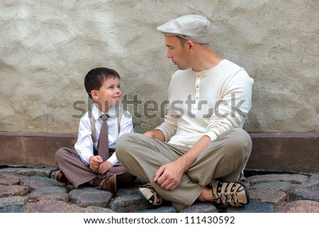 Young father and son outdoors in city - stock photo