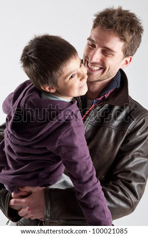 Young father and son playing together portrait. Studio shot.