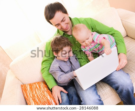 Young father and two kids with laptop