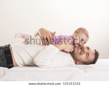 Young father is having fun with his little baby