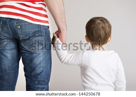 Young father is playing with his son