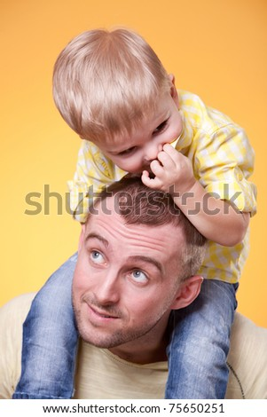 Young father play with son on his shoulders