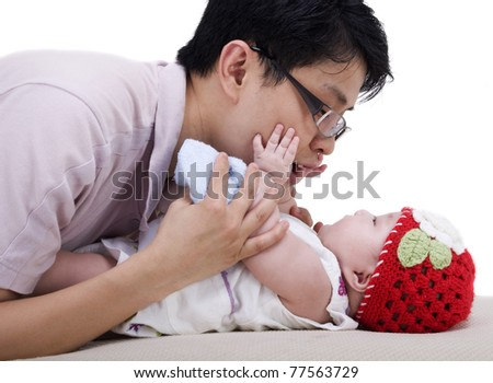 young father playing with his 4 months old baby girl