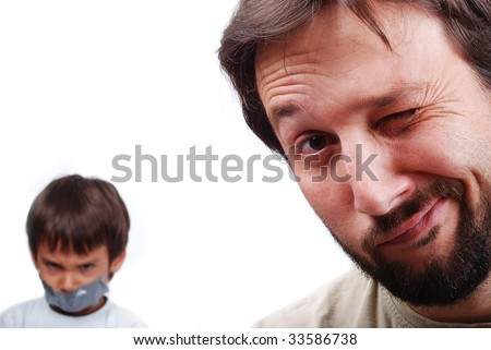 Young father resolving a problem with the son - stock photo