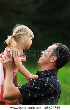 Young father with his daughter on the nature