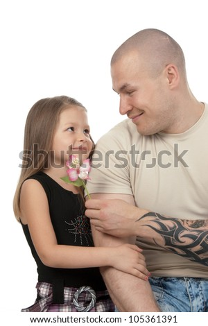 Young father with his happy daughter looking at each other