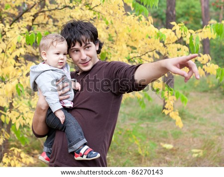 young father with son pointing into the distance