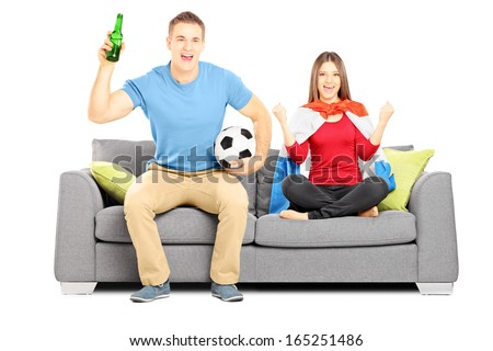 Young female and male football supporters cheering, isolated on white background
