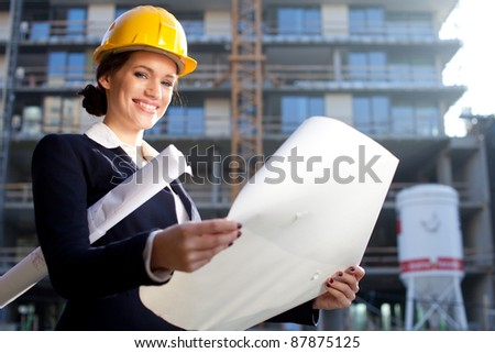Young female architect construct ion engineer at a construction site
