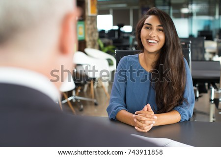 Young female candidate laughing at job interview Foto d'archivio ©