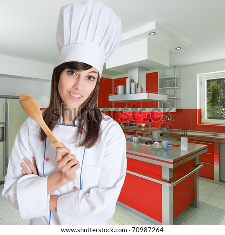 Young female chef holding a wooden spoon in a beautiful kitchen