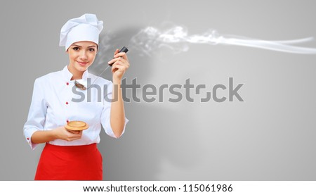 Young female chef in red apron against collour background