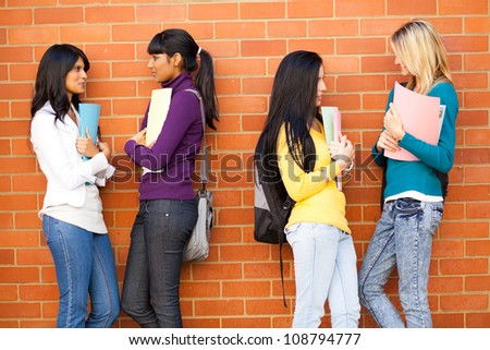young female college friends chatting