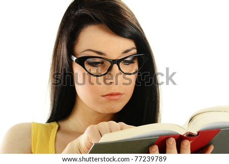 Young female college student with a book isolated on white. Woman reading