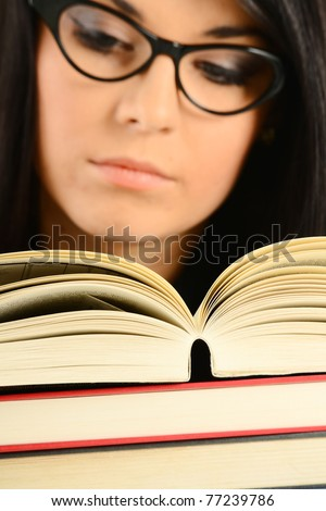 Young female college student with books. Woman reading.