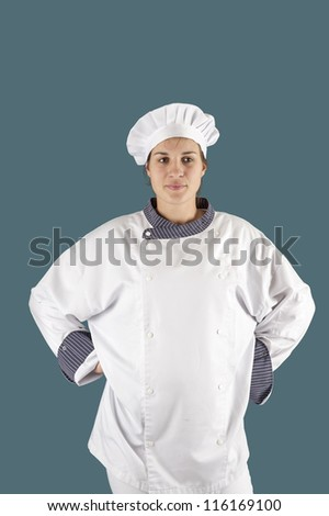 young female cook, arms in hips, Isolated on blue background - stock photo