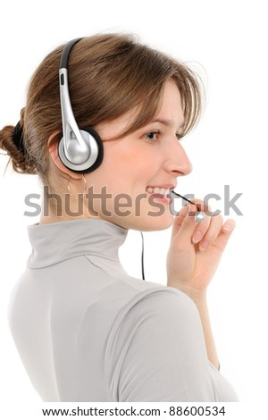 Young female customer service representative in headset, smiling  on a white background