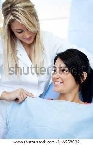 young female dentists assistant preparing  patient
