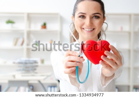 Young female doctor cardiologist working in the clinic