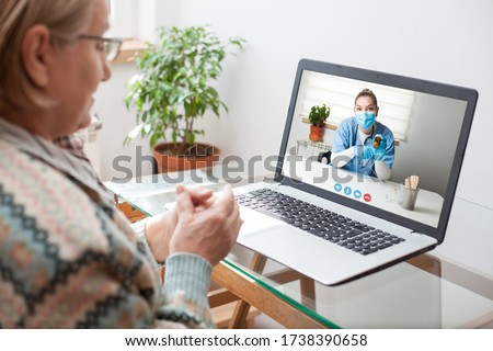 Young female doctor consulting with elderly woman over video help line virtual medical appointment chat,GP prescribing medication to senior patient,telemedicine diagnosis,therapy and treatment concept