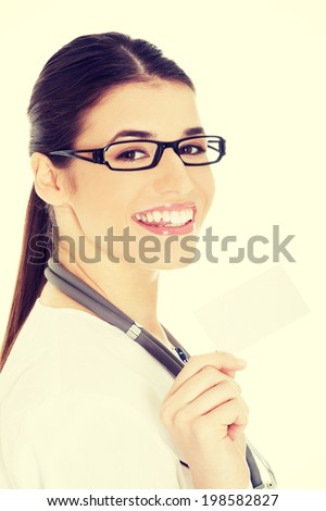 Young female doctor holding business card