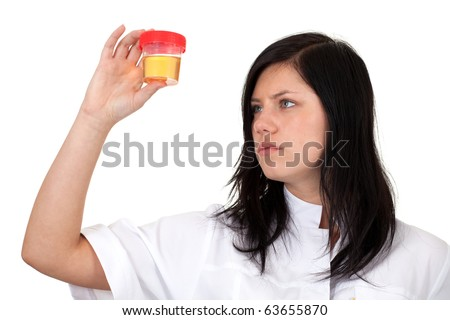 young female doctor in white workwear  keeping urine to analysis