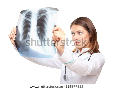 Young female doctor looking at the x-ray picture of lungs isolated on white background