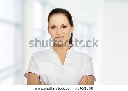 Young female doctor or nurse isolated on white background