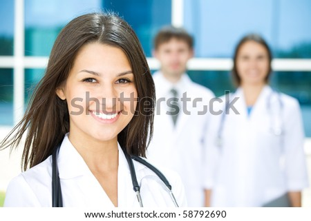 Young female doctor stand against a hospital building