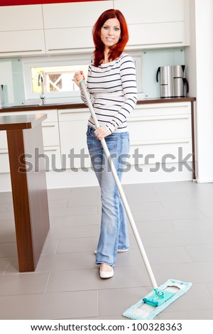 Young female doing housework