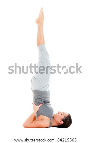 young female doing yoga exercise on floor. isolated on white background