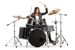 Young female drummer playing drums with drumsticks isolated on white background