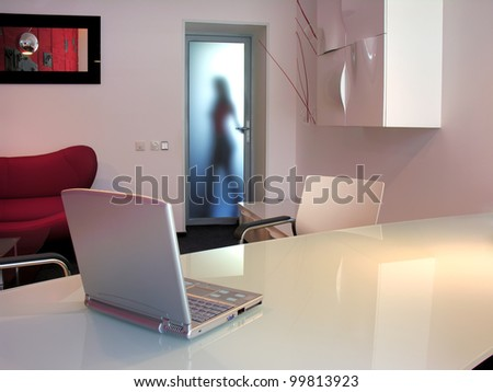 young female employee go out from office